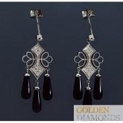 Золотые серьги с бриллиантами и ониксом